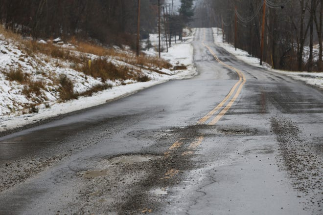 Fluctuating winter temperatures produced the typical crop of potholes in 2019, including this set on North River Road West.