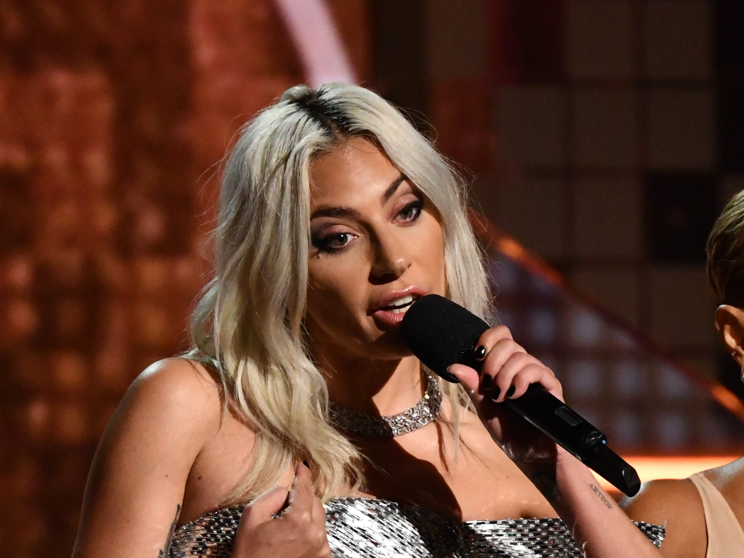 Lady Gaga, speaks during the GRAMMY Awards.