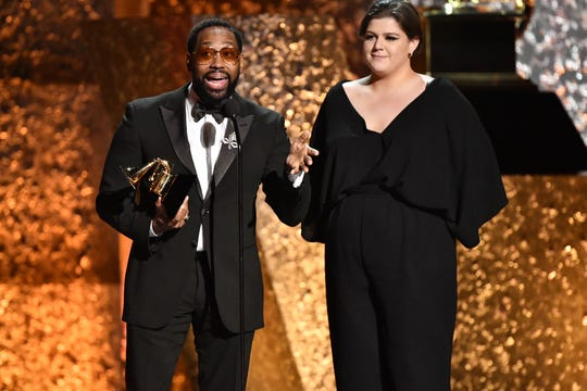"PJ Morton, left, and Yebba accept the award for Best Traditional R&B Performance for ""How Deep Is Your Love."""