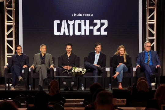 "Grant Heslov (left), George Clooney, Christopher Abbott, Kyle Chandler, Ellen Kuras and Luke Davies promote Hulu's  ""Catch-22"" at the Television Critics Association."