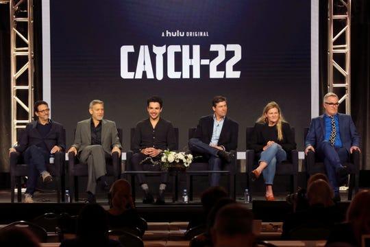 "Grant Heslov (left), George Clooney, Christopher Abbott, Kyle Chandler, Ellen Kuras and Luke Davies promote Hulu's  ""Catch-22"" at the Television Critics Association."
