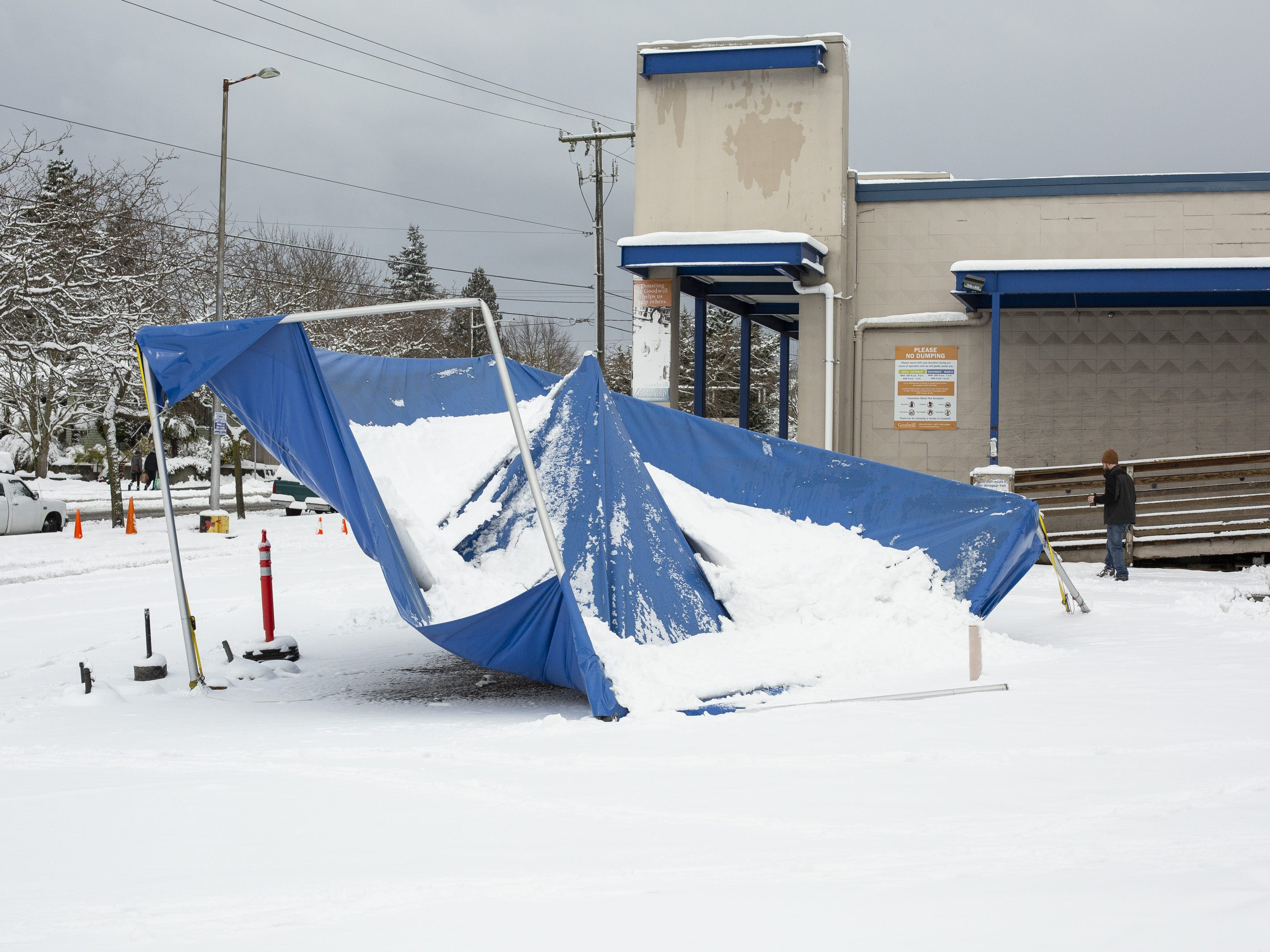 A tent collapsed by the weight of snow is pictured at a Goodwill retail location after a large storm blanketed the city with snow on February 9, 2019 in Seattle, Washington.