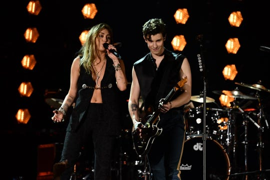"""Miley Cyrus and Shawn Mendes perform """"In My Blood"""" during the 61st Annual Grammy Awards on Feb. 10, 2019, in Los Angeles."""