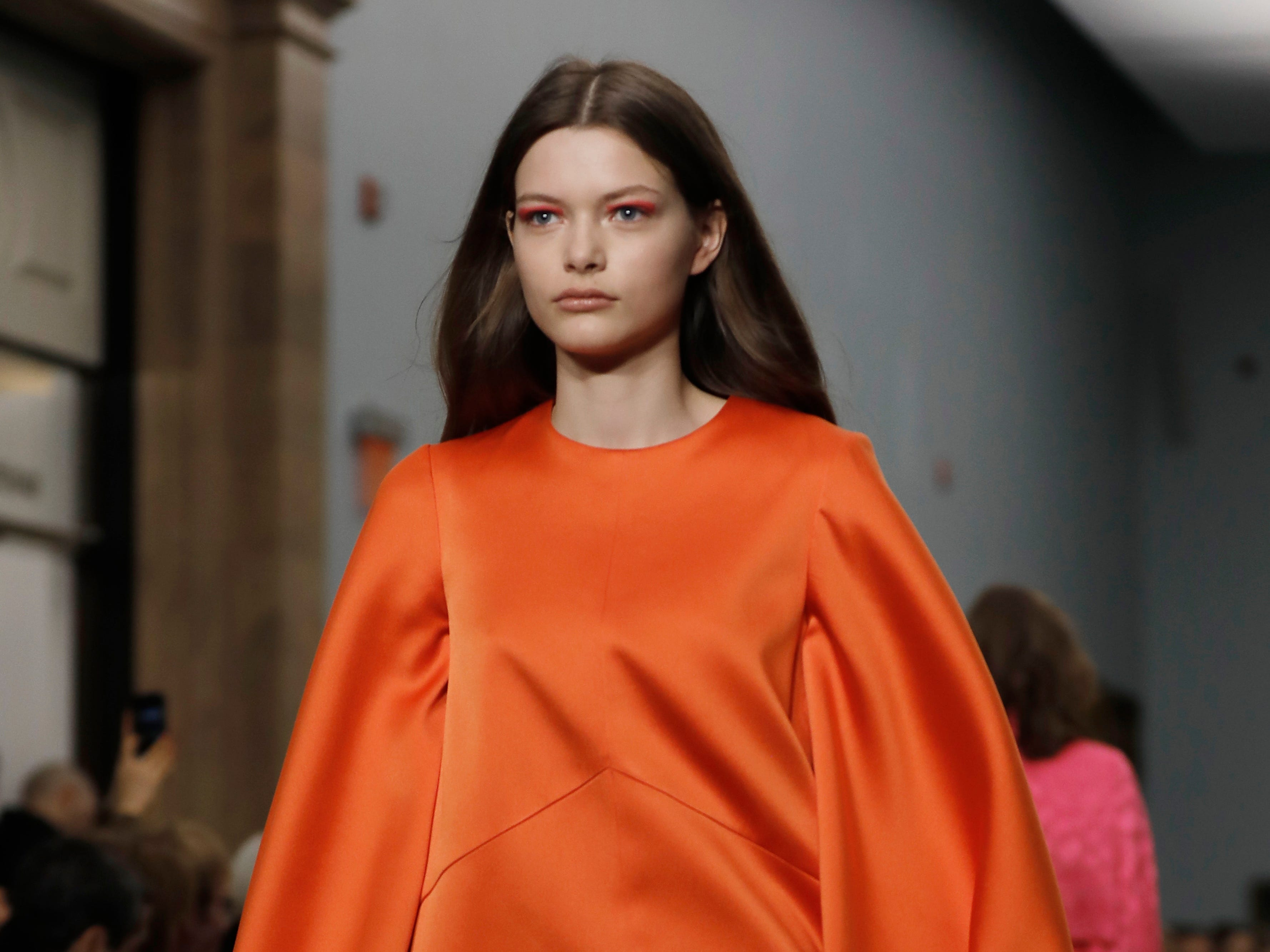 A few of Herrera's looks committed to color, like this orange minidress with tuip sleeves.