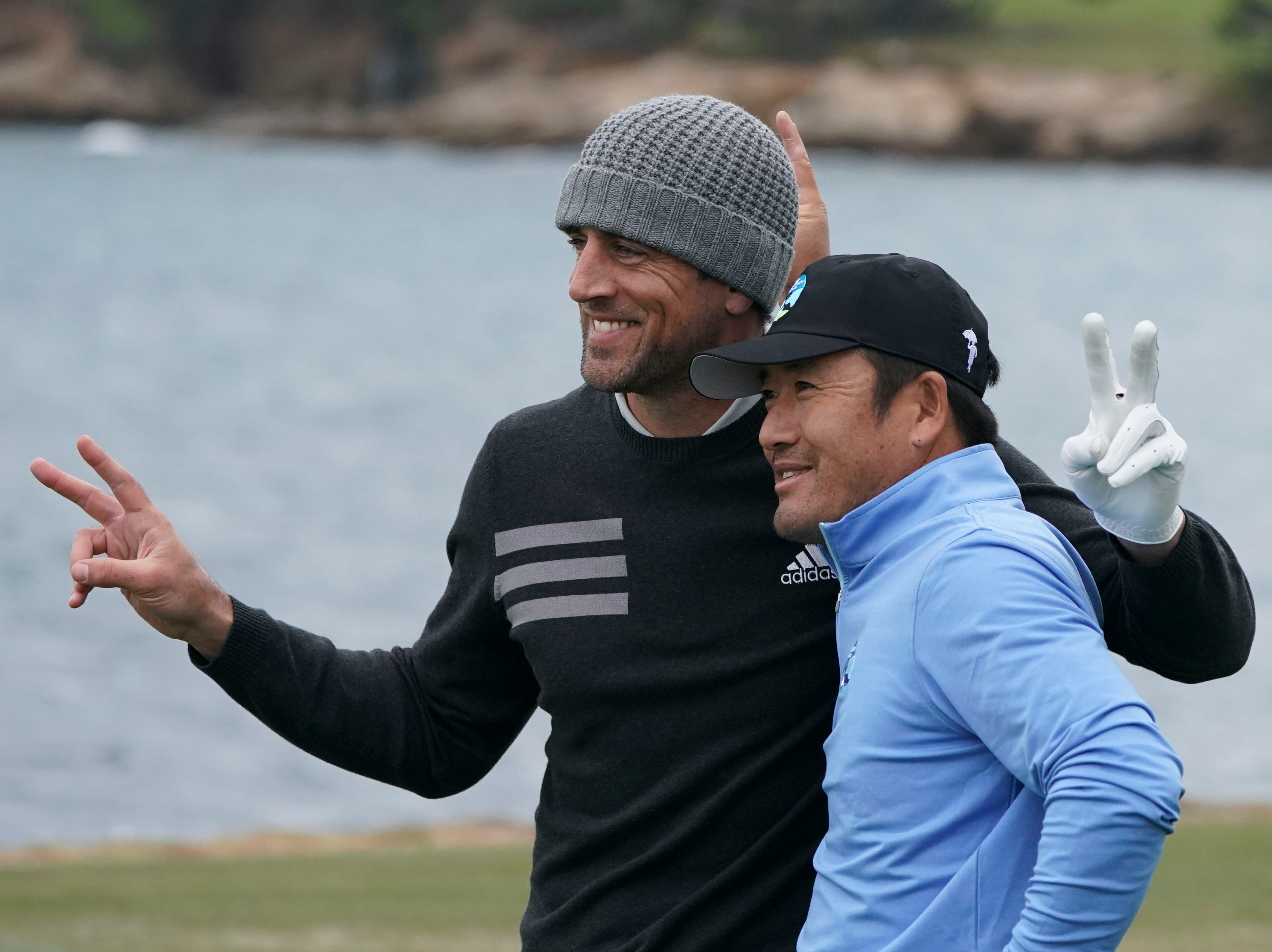 Green Bay Packers Aaron Rodgers, left,  and golfer Ho-sung Choi pose for a photo on the 18th tee box during the third round.