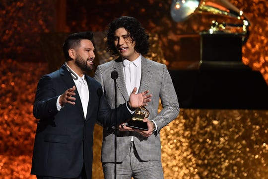 """Shay Mooney, left, and Dan Smyers of Dan + Shay accept the award for Best Country Duo/Group Performance for """"Tequila."""""""