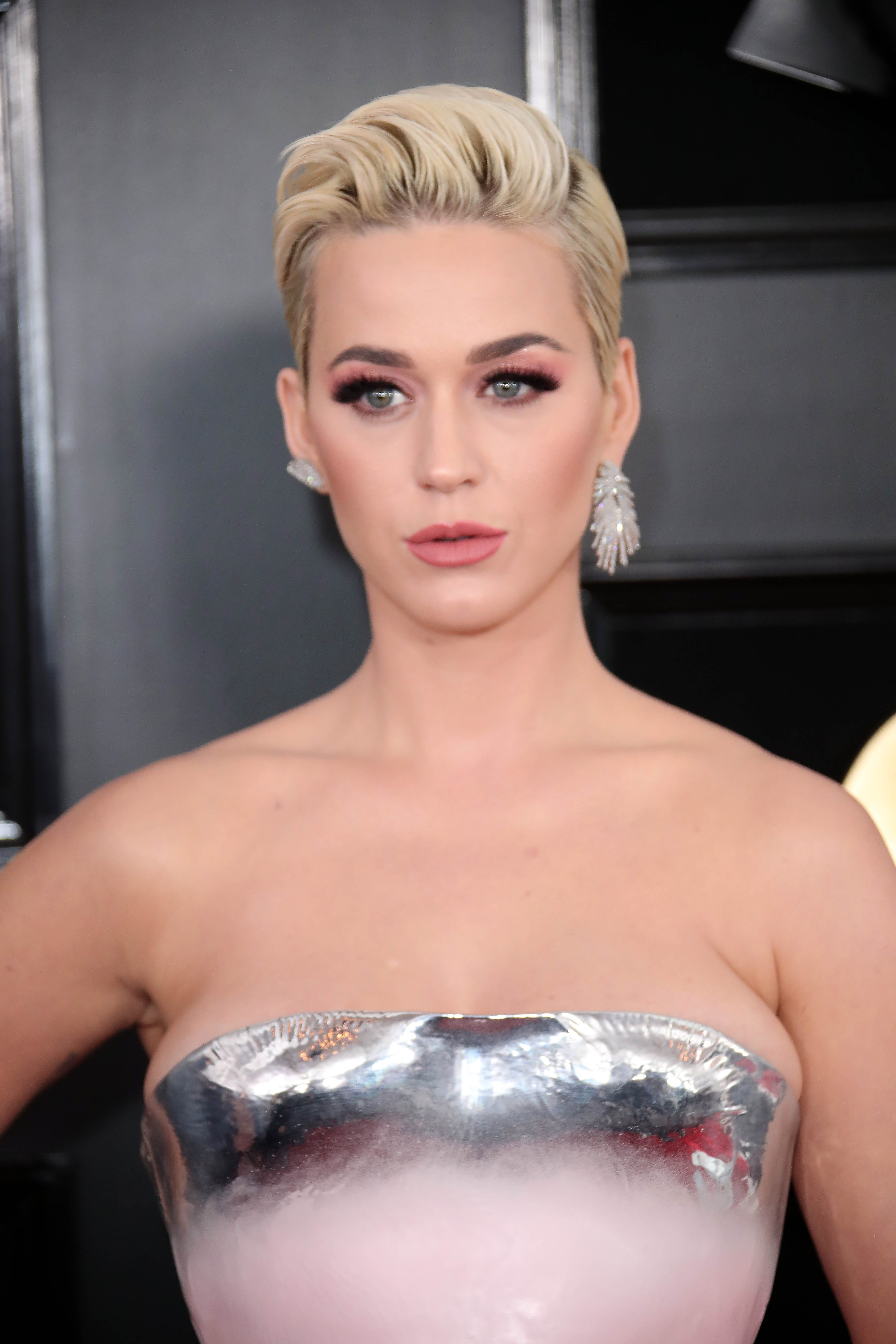 Katy Perry pays tribute to late grandma, shares emotional video telling her she s pregnant