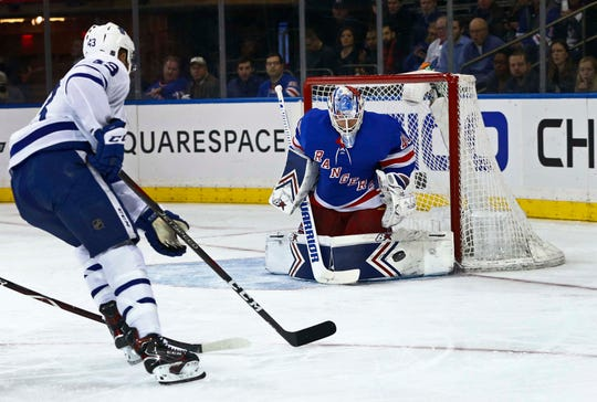 New York Rangers goaltender Alexandar Georgiev stops Toronto Maple Leafs center Nazem Kadri, who had a team-high 12 shots.