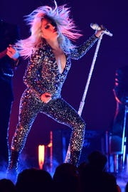 Lady Gaga curiously chose an '80s glam-rock look to perform