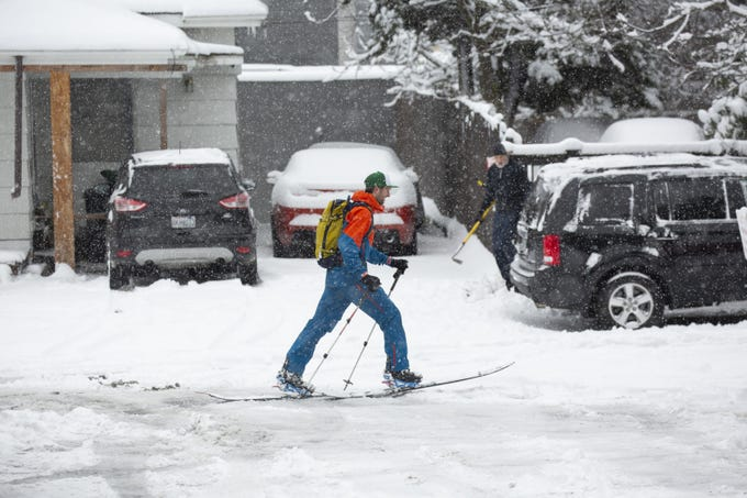 A skier is seen on a road in the Ballard neighborhood after a large storm blanketed the city with snow on February 9, 2019 in Seattle, Washington. Seattle almost reached its yearly amount of snowfall in a day.