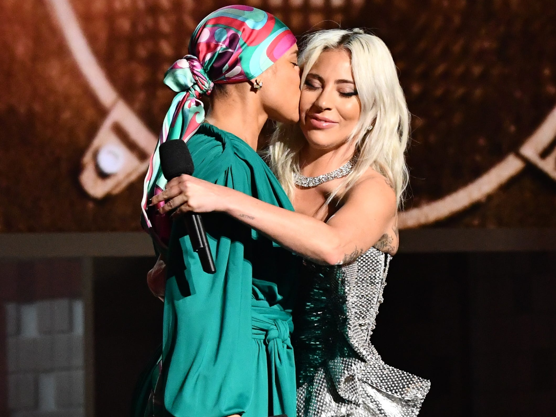 Alicia Keys and Lady Gaga hug during the  Grammy Awards.
