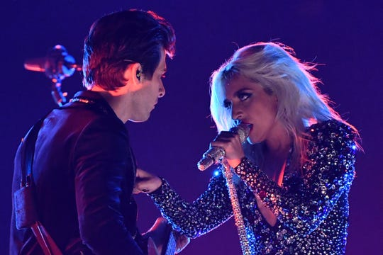 "Lady Gaga performs ""Shallow"" with Mark Ronson on acoustic guitar."