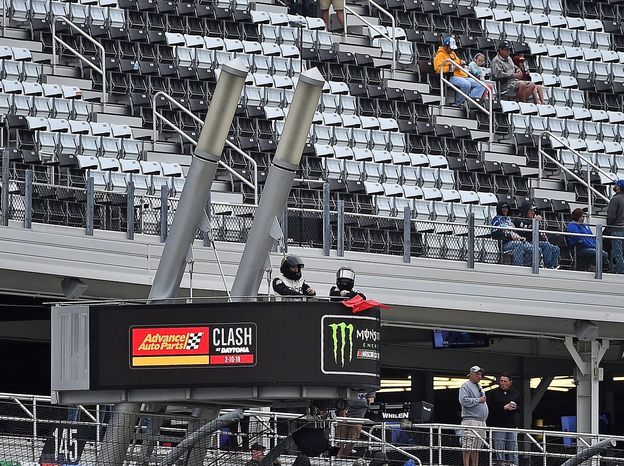 Feb 10: A NASCAR official displays the red flag for rain during the Advance Auto Parts Clash at Daytona International Speedway. The race was called for rain after Jimmie Johnson took the lead following a multi-car wreck.