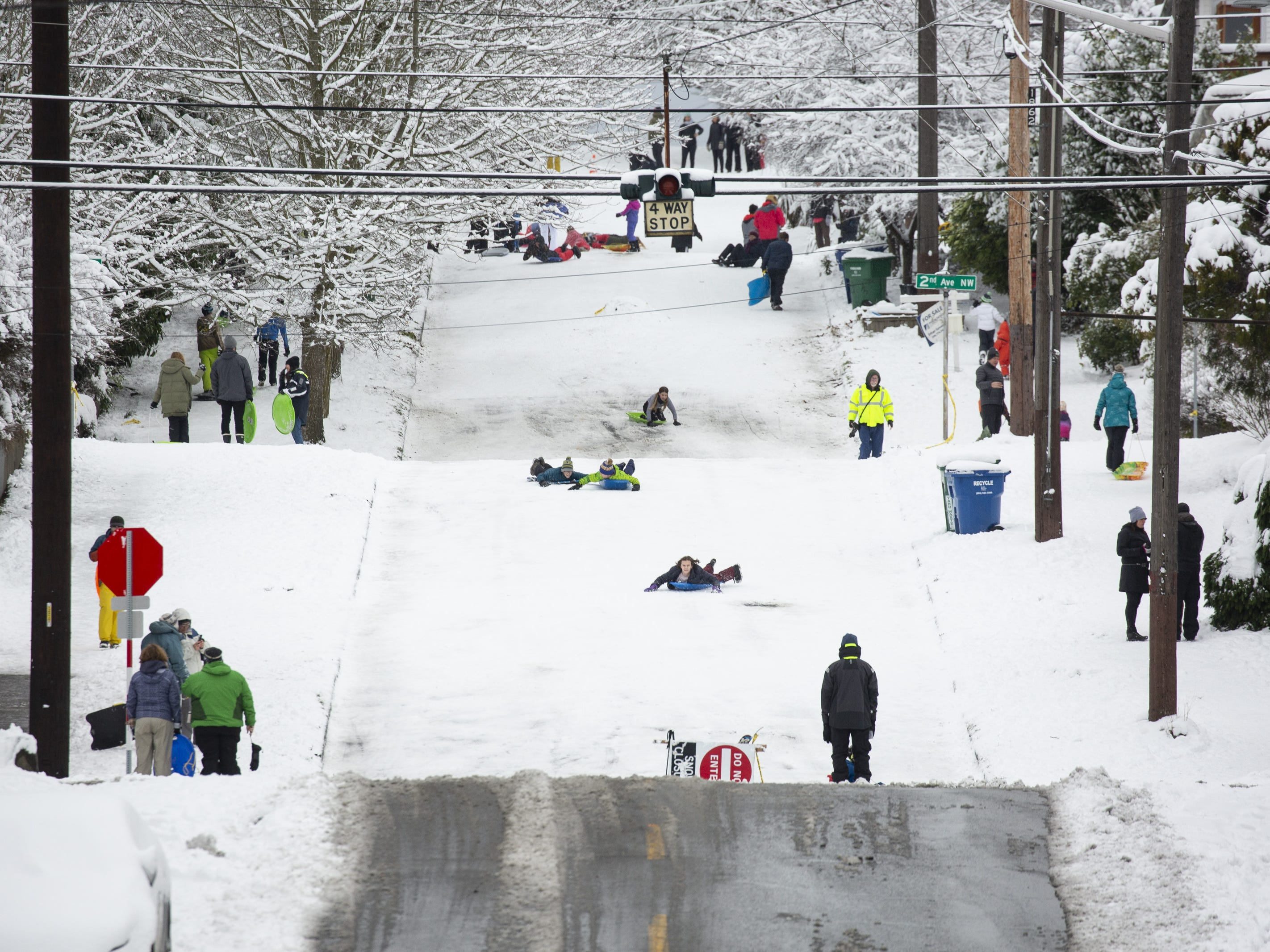 People play on a hill in the Phinney Ridge neighborhood after a large storm blanketed the city with snow on February 9, 2019 in Seattle, Washington.