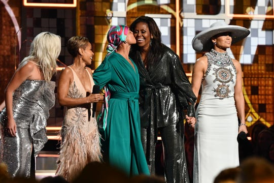 Lady Gaga (from left), Jada Pinkett Smith, Alicia Keys, Michelle Obama and Jennifer Lopez celebrate the power of music at the Grammys.