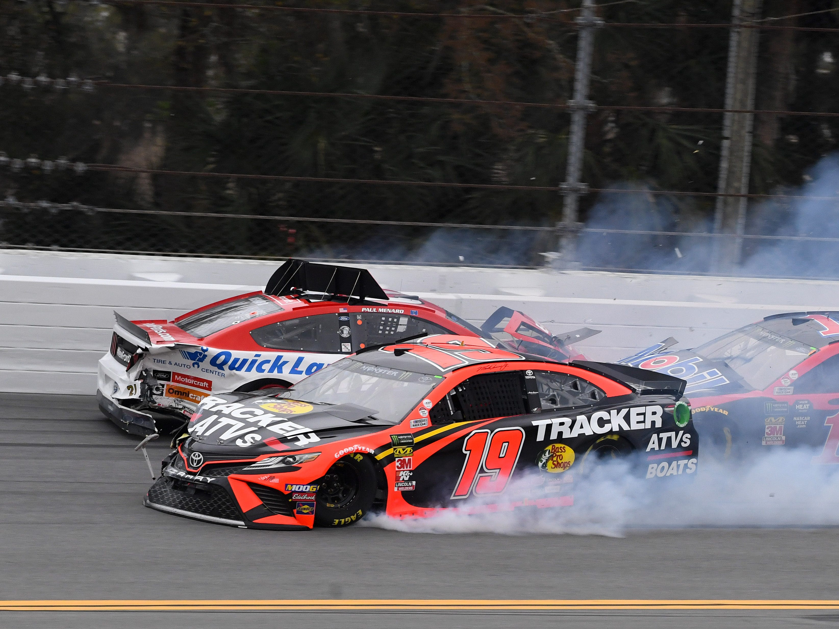 Feb 10: Martin Truex Jr. (19) gets caught up in the multi-car wreck triggered by Paul Menard (21) and Jimmie Johnson (not pictured).