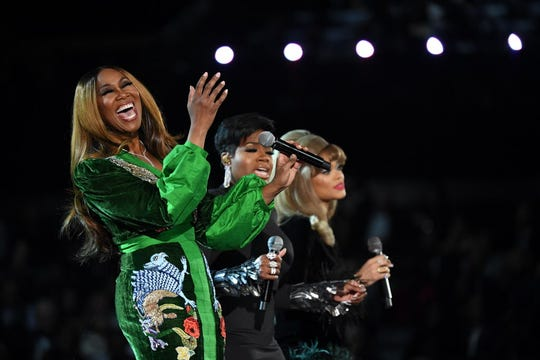From left, Yolanda Adams, Fantasia and Andra Day perform an Aretha Franklin tribute at the Grammys.