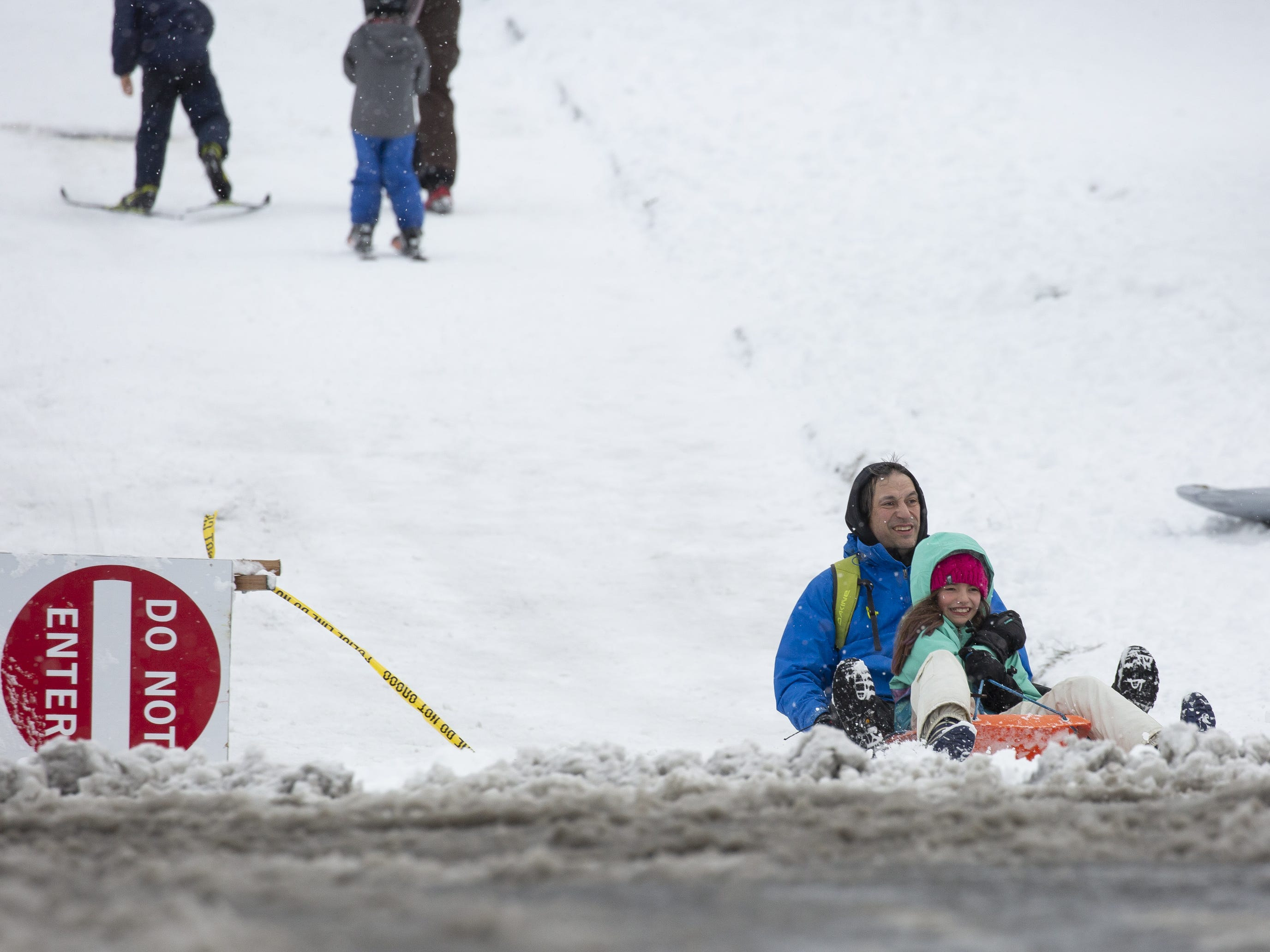 People sled on a hill in the Phinney Ridge neighborhood after a large storm blanketed the city with snow on February 9, 2019 in Seattle, Washington.
