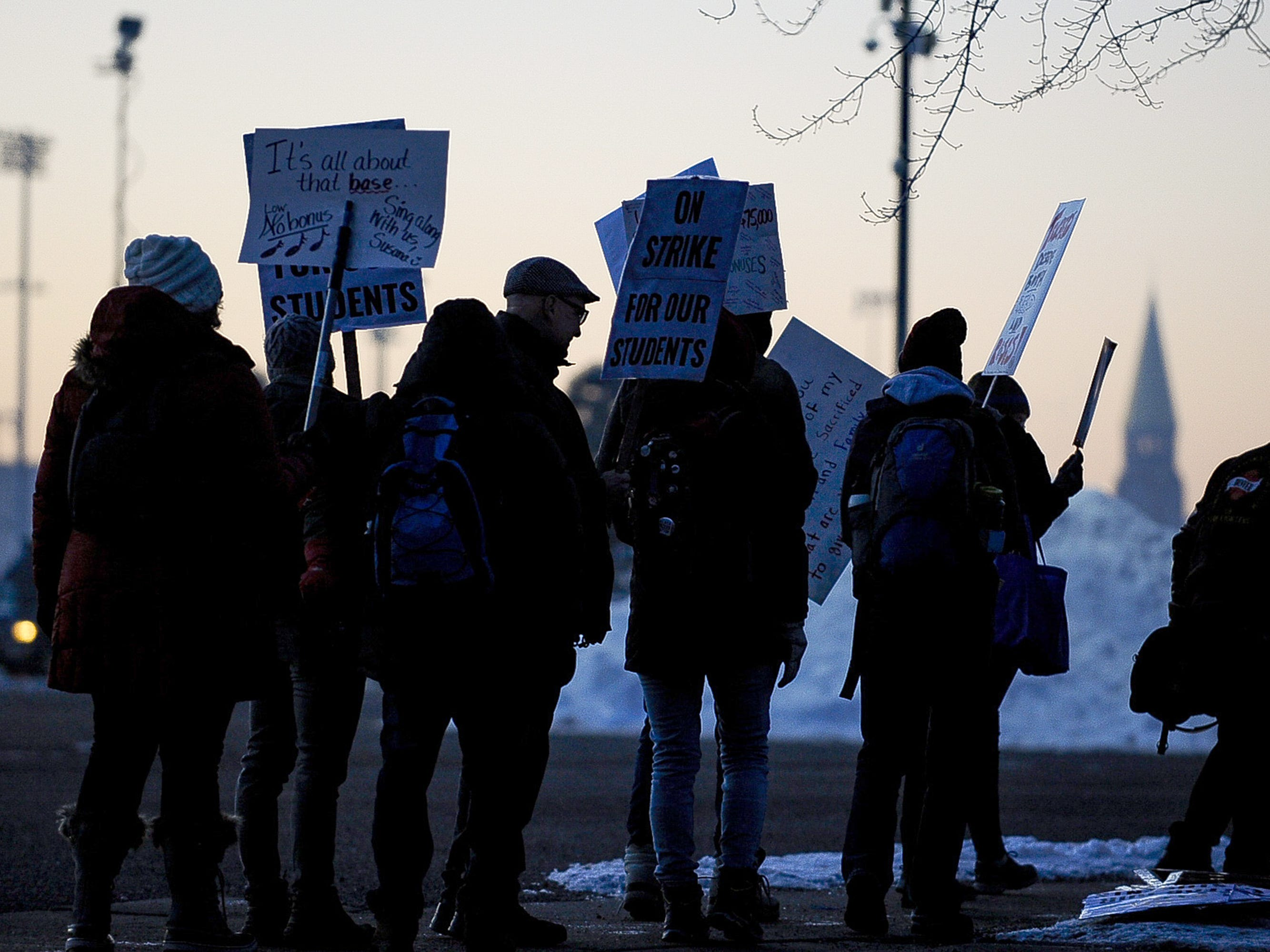 DENVER, CO - FEBRUARY 11: Denver Public Schools teachers and members of the community picket at sunrise outside South High School on February 11, 2019 in Denver, Colorado. Denver teachers are striking for the first time in 25 years after the school district and the union representing the educators failed to reach an agreement after 14 months of contract negations over teacher pay. (Photo by Michael Ciaglo/Getty Images) ORG XMIT: 775295992 ORIG FILE ID: 1097895692
