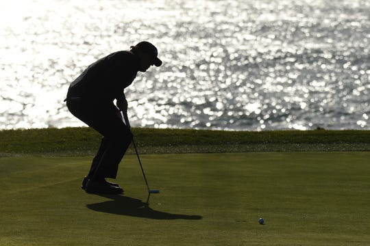 Phil Mickelson will resume play Monday with a three-shot lead at Pebble Beach.
