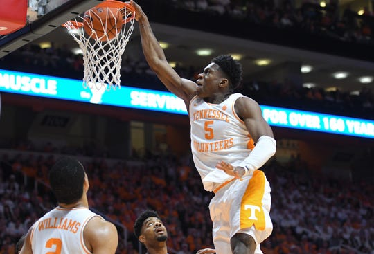 Tennessee guard Admiral Schofield dunks the ball during his team's game against Florida.
