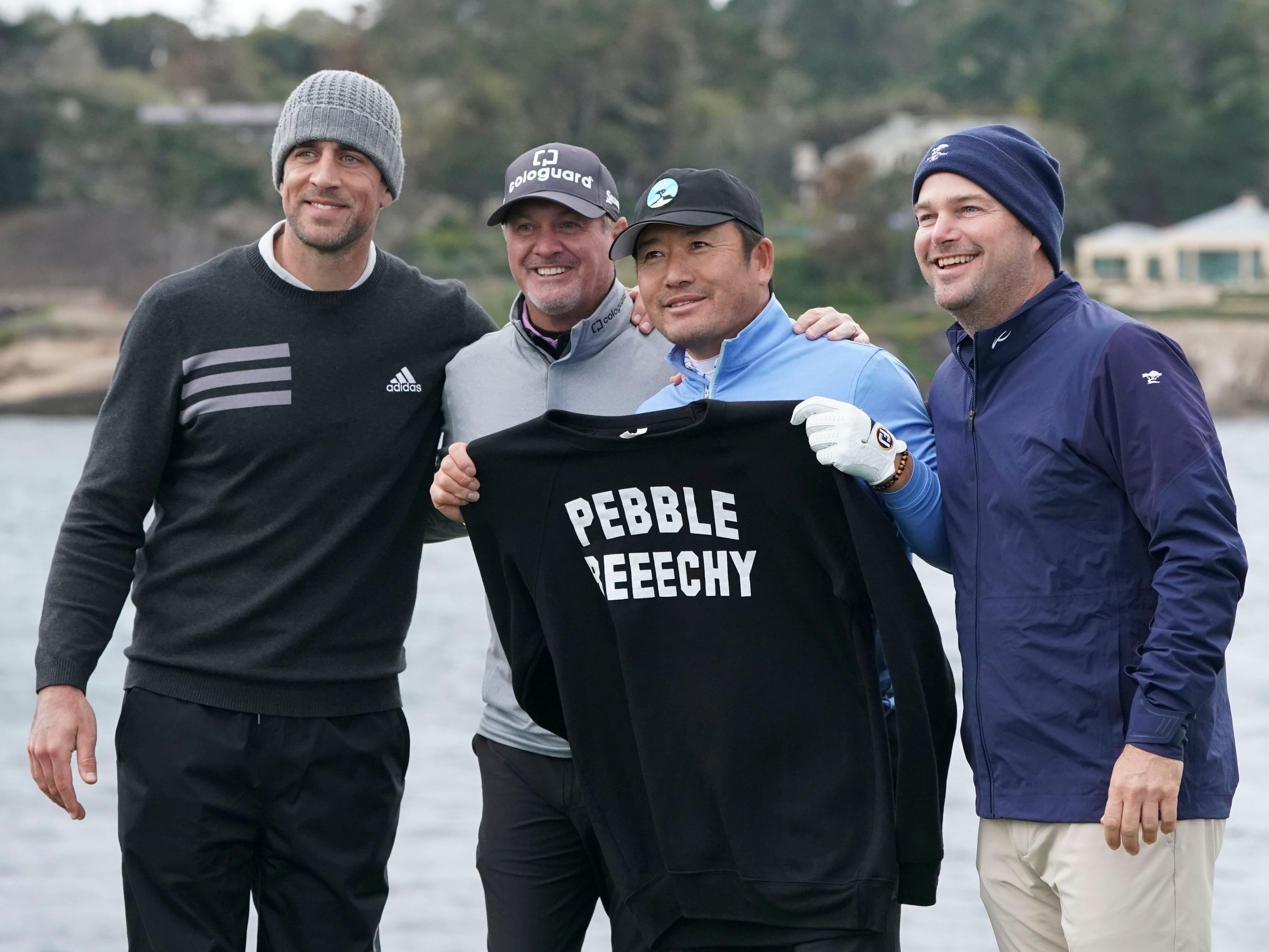 (From left to right) Green Bay Packers quarterback Aaron Rodgers, golfers Jerry Kelly and Ho-sung Choi, and actor Chris O'Donnell pose on the 18th tee box during the third round.
