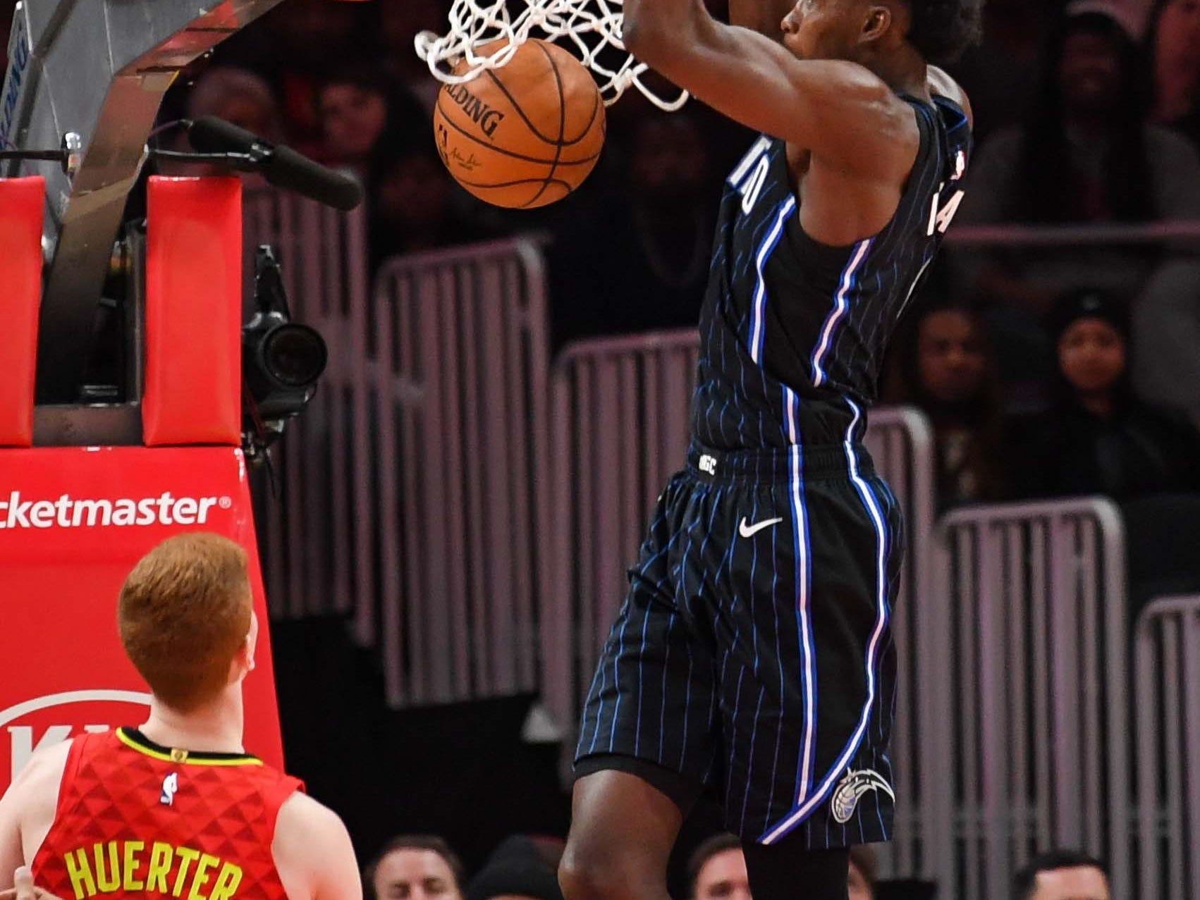 Feb 10: Orlando Magic forward Jonathan Isaac throws one down as Atlanta Hawks guard Kevin Huerter looks on.