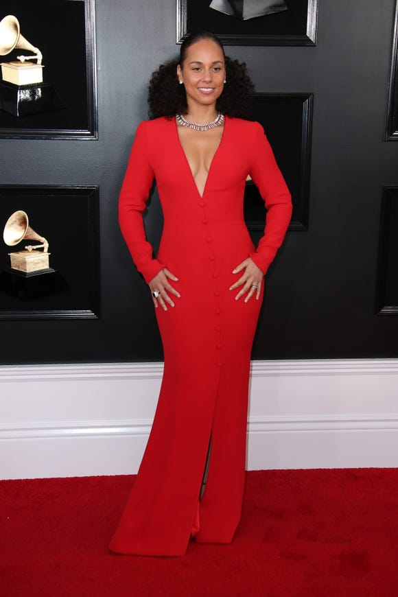 Alicia Keys in a figure hugging Armani gown complete with Bvlgari jewels at the 2019 Grammys.