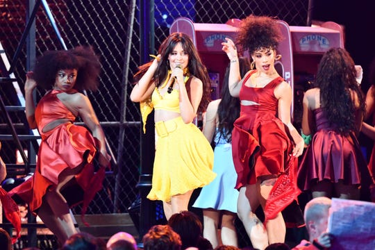 "Camila Cabello (in yellow) performs ""Havana"" during the opening of the 61st annual Grammy Awards."