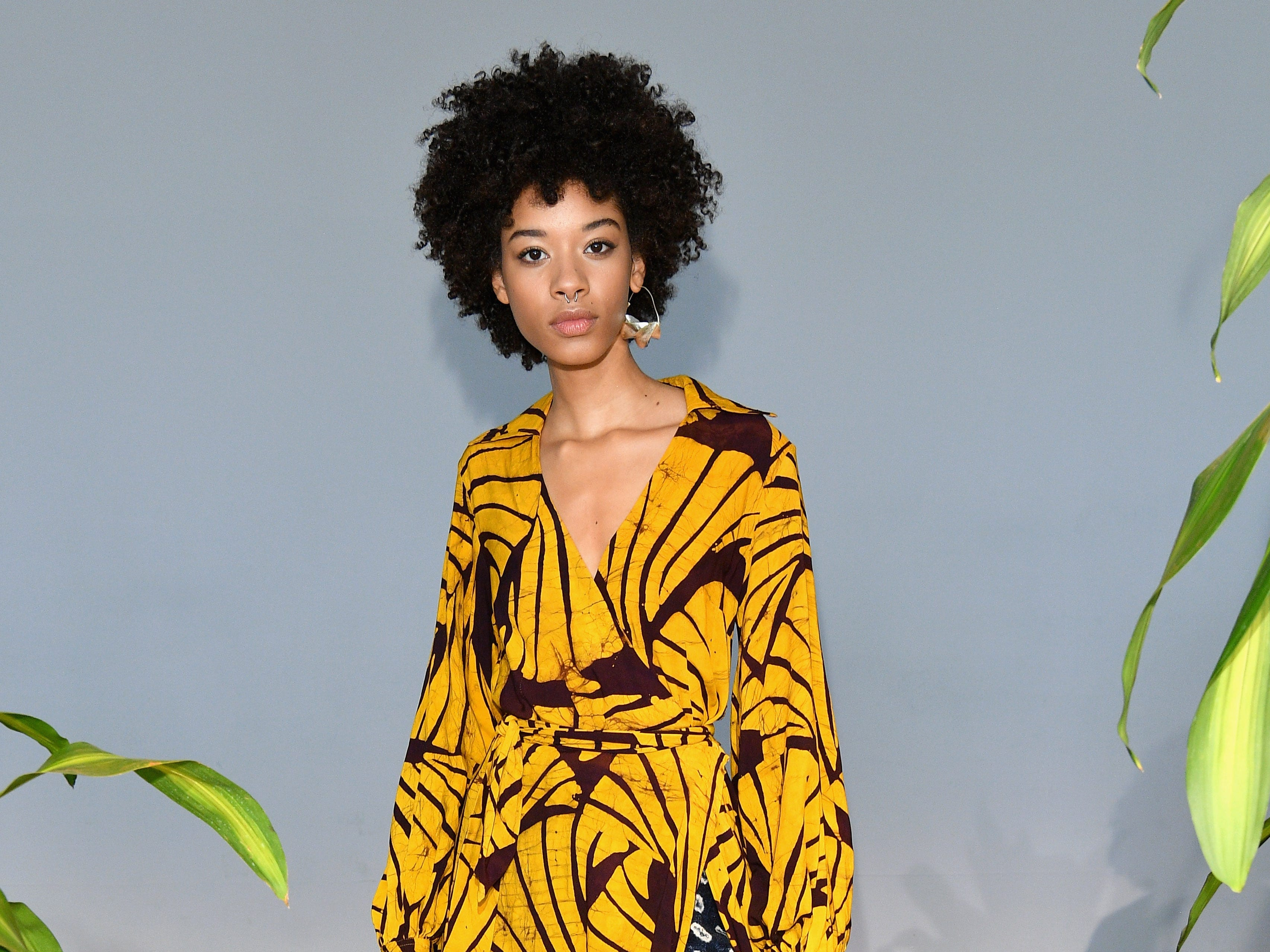 Studio 189 diverted from the triangle theme pattern for this look, which layered a canary-yellow printed wrap dress over a pair of silky black-and-white pants.