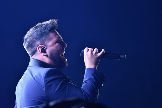"""Shay Mooney of Dan + Shay performs """"Tequila"""" during the Grammys."""