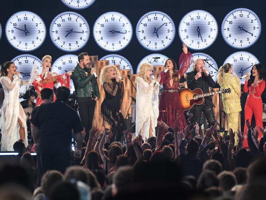 "From left, Maren Morris, Katy Perry, Little Big Town, Miley Cyrus and Kacey Musgraves perform ""9 to 5"" with Dolly Parton as part of a tribute to Dolly Parton during the Grammys"