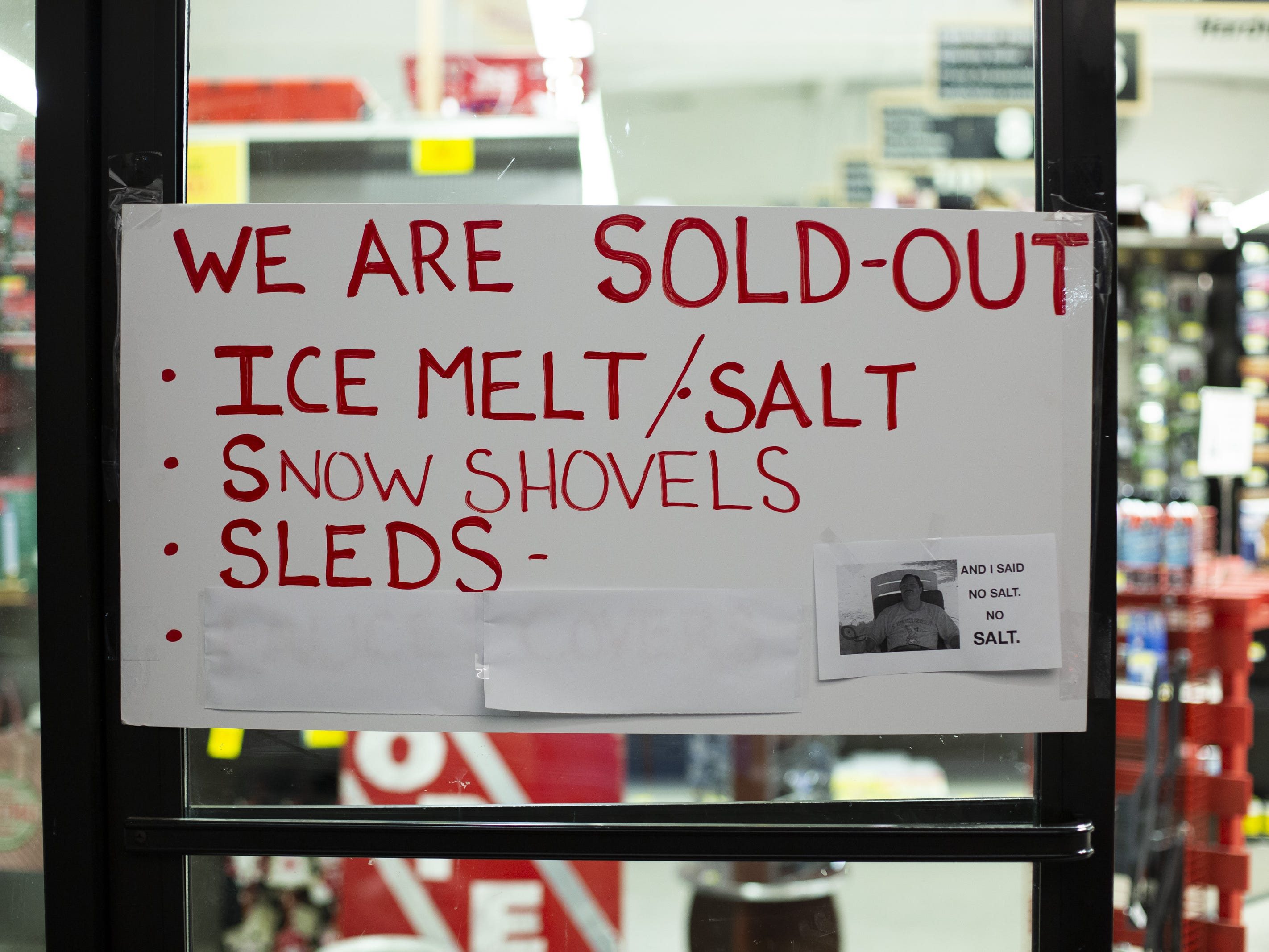 A sign at a hardware store warns customers that there is no remaining ice melt, salt, snow shovels, or sleds for sale on February 8, 2019 in Seattle, Washington.