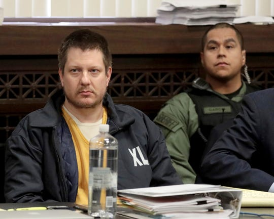 FILE - in this Dec. 14, 2018, file photo, former Chicago police Officer Jason Van Dyke, left, appears for a hearing at the Leighton Criminal Court Building, in Chicago.