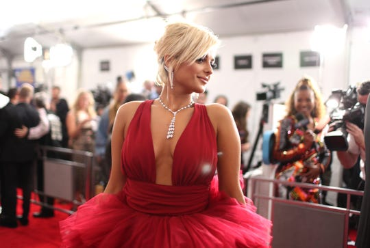 Bebe Rexha rocked an awesome multilayer red tulle dress Sunday at the Grammy Awards in LA.