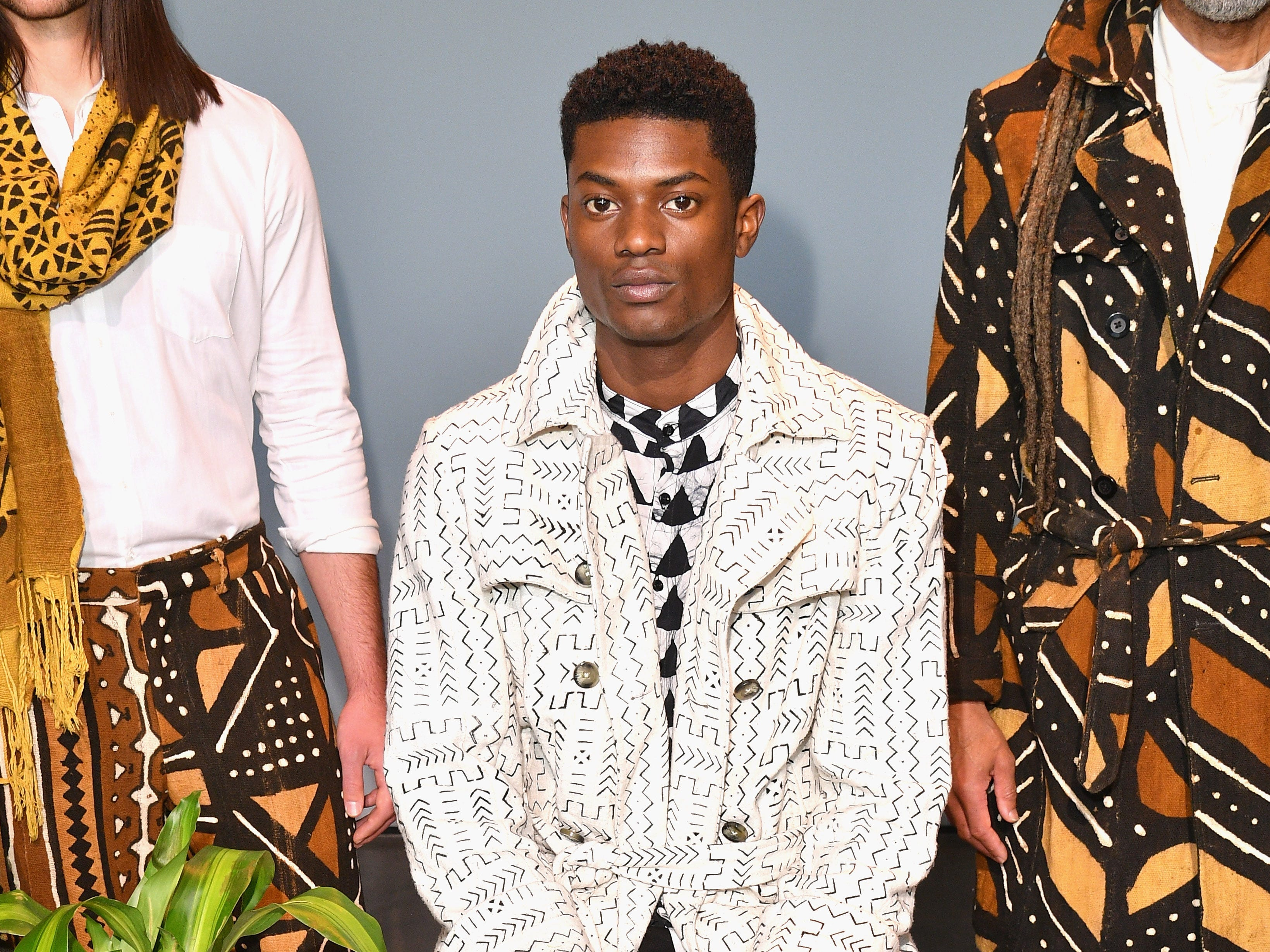 The triangles could also be spotted on this men's shirt under a white-and-black patterned trench coat from Studio 189.