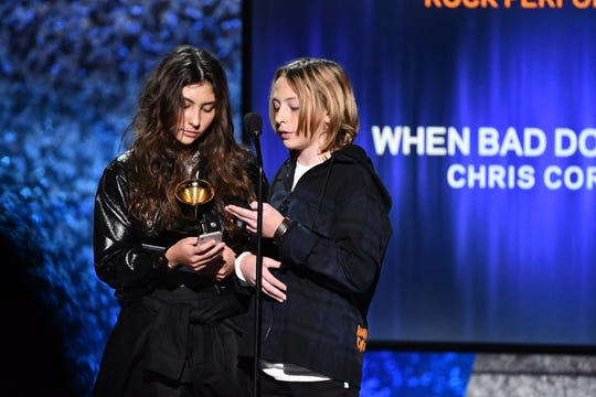 "Toni Cornell (L) and Christopher Nicholas Cornell appear on behalf of their father Chris Cornell to accept the award for best rock performance for ""When Bad Does Good"" at the Grammy Awards premiere ceremony."