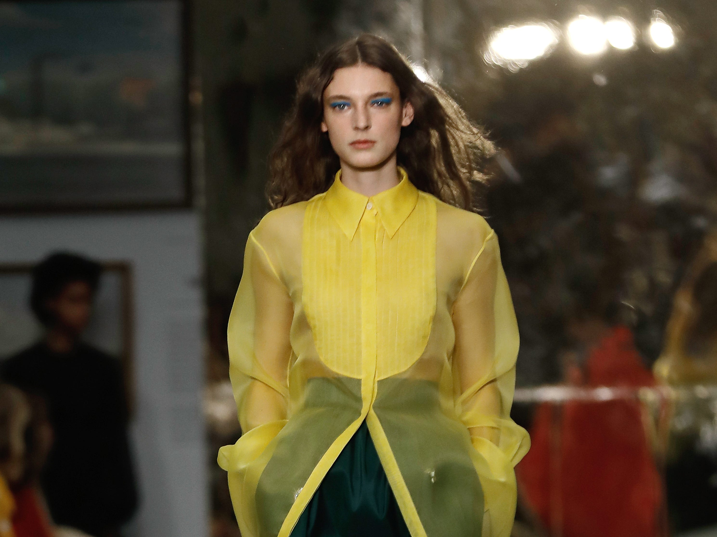 A sheer, canary-yellow tuxedo shirt from Carolina Herrera topped a dark skirt with matching embroidery.