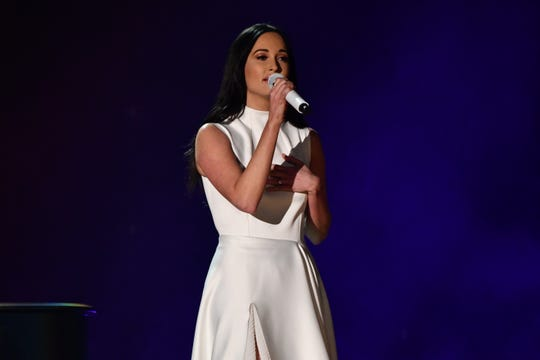 """Kacey Musgraves performs """"Rainbow"""" during the 61st Grammy Awards. She won three honors, including best country album."""