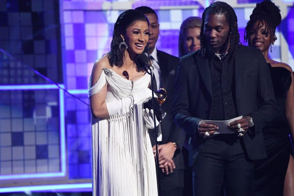 "Cardi B accepts the award for best rap album for ""Invasion of Privacy"" with husband Offset joining her onstage."