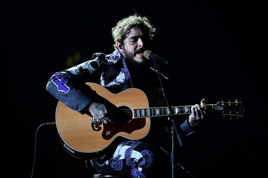 Post Malone performs during the Grammys.
