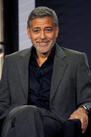 "George Clooney laughs at the idea that he and wife Amal will serve as godparents to Prince Harry and Duchess Meghan's child while promoting his Hulu reboot of ""Catch 22"" Feb. 11 at the Television Critics Association winter press tour in Los Angeles. Although they attended the royal couple's wedding, the father of twin toddlers said, ""I have enough (expletive) to deal with – literally."""