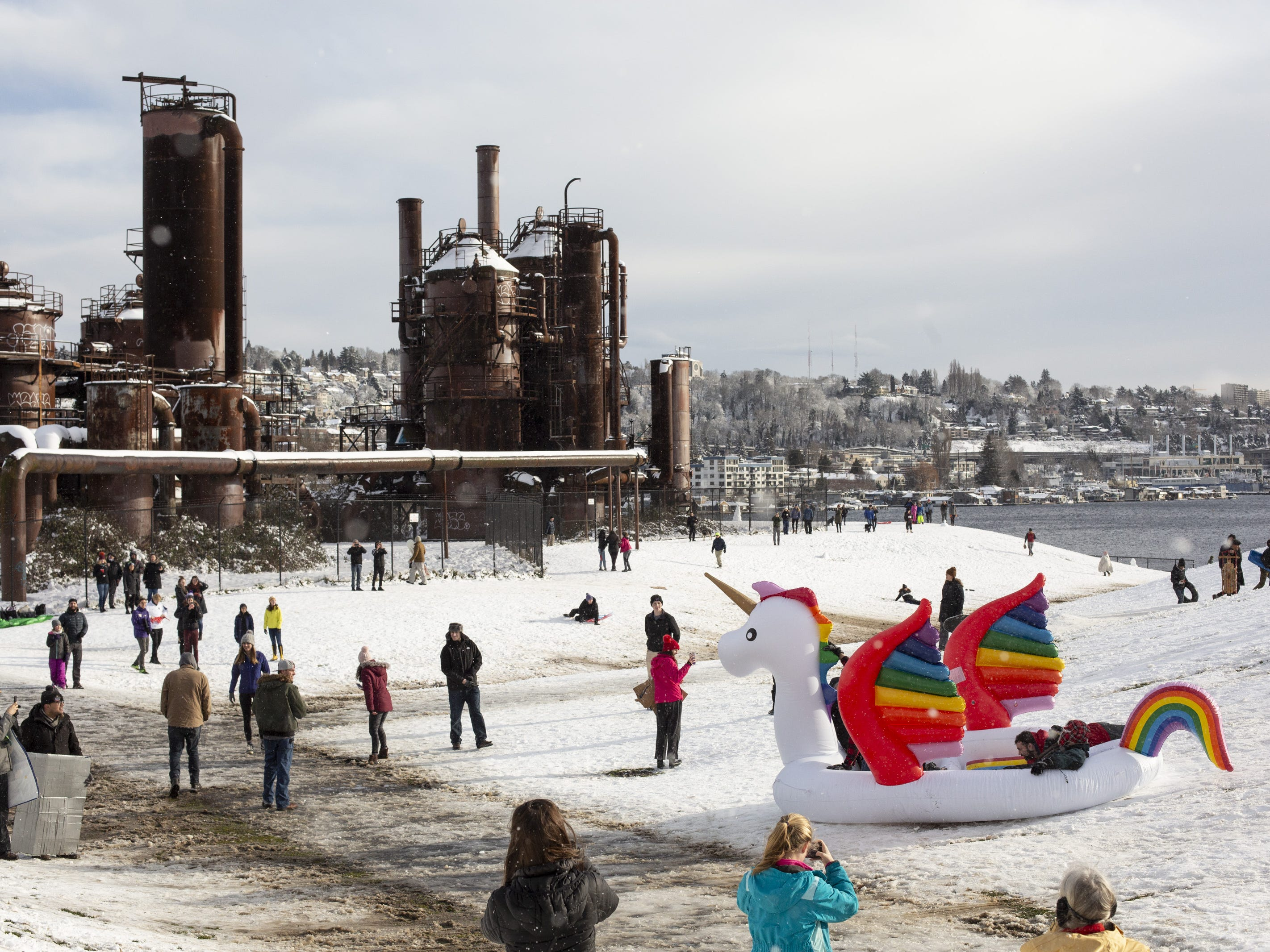 People play at Gas Works Park after a large storm blanketed the city with snow on February 9, 2019 in Seattle, Washington.