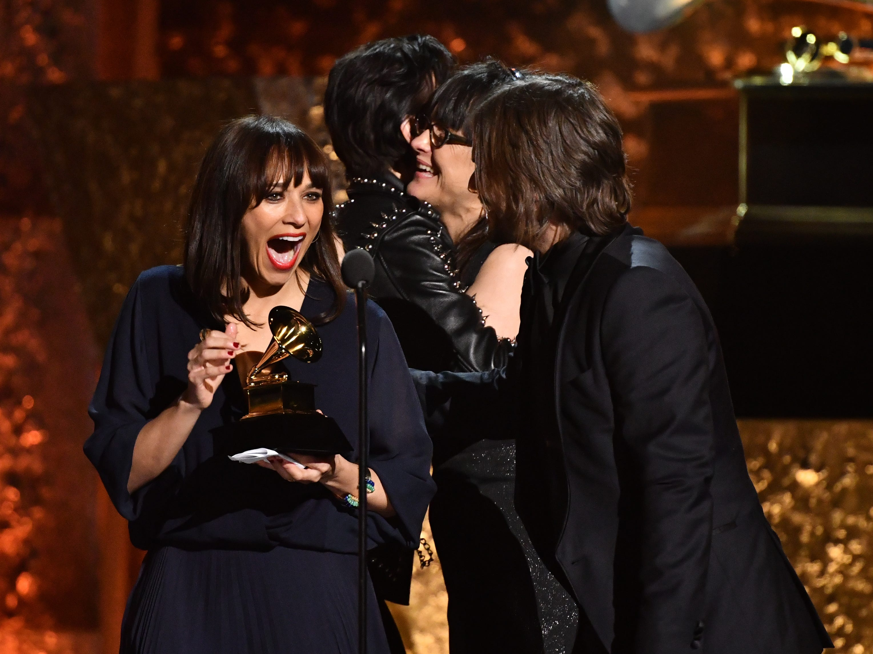 Rashida Jones. left, accepts the award for Best Music Film for Quincy at the Grammy Awards Premiere Ceremony.