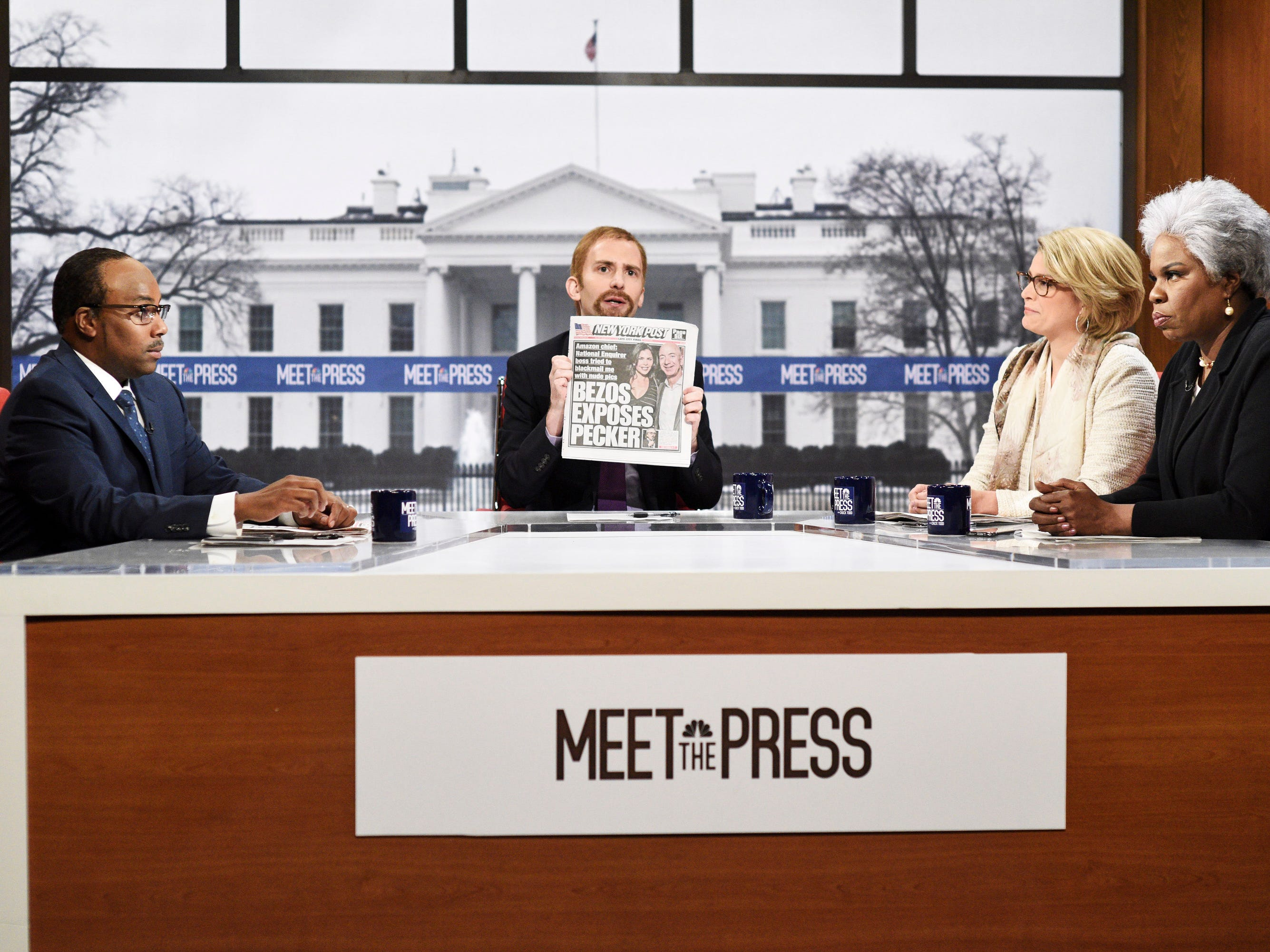 "Kenan Thompson as Eugene Robinson, Kyle Mooney as Chuck Todd, Cecily Strong as Peggy Noonan, and Leslie Jones as Donna Brazile poke fun at the fight between Jeff Bezos and the National Enquirer during a parody of ""Meet the Press."""