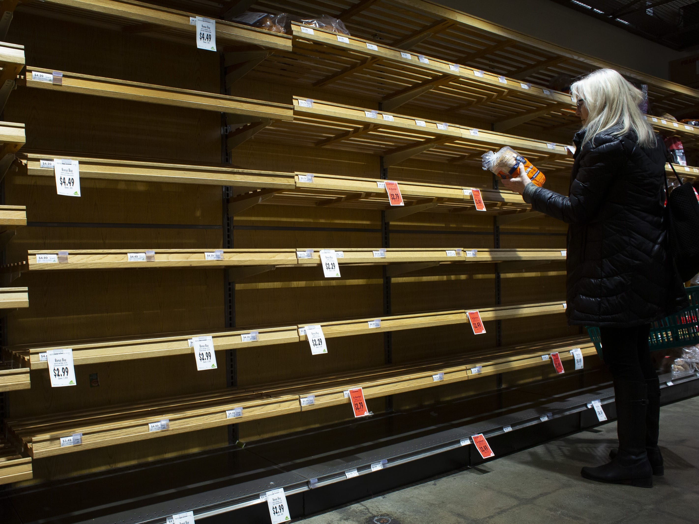 A woman shops for bread at a grocery store with very few options left on February 8, 2019 in Seattle, Washington.