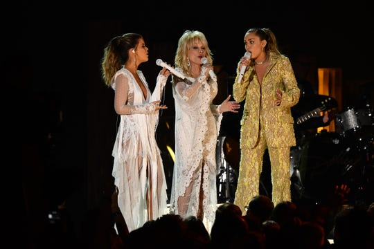 "From left, Maren Morris, Dolly Parton, and Miley Cyrus perform ""After the Gold Rush"" as part of a tribute to Dolly Parton at the Grammys on Feb. 10, 2019."