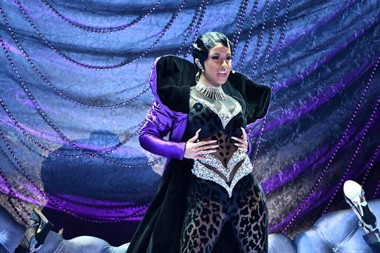 "Cardi B performs ""Money"" at the Grammys."