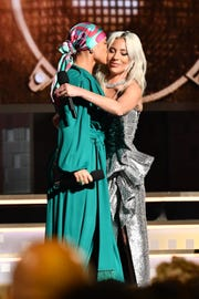 "Lady Gaga, right, get a congratulatory kiss on the cheek from Grammy host Alicia Keys after she wins best pop duo or group performance for ""Shallow,"" her duet with Bradley Cooper from ""A Star Is Born."""