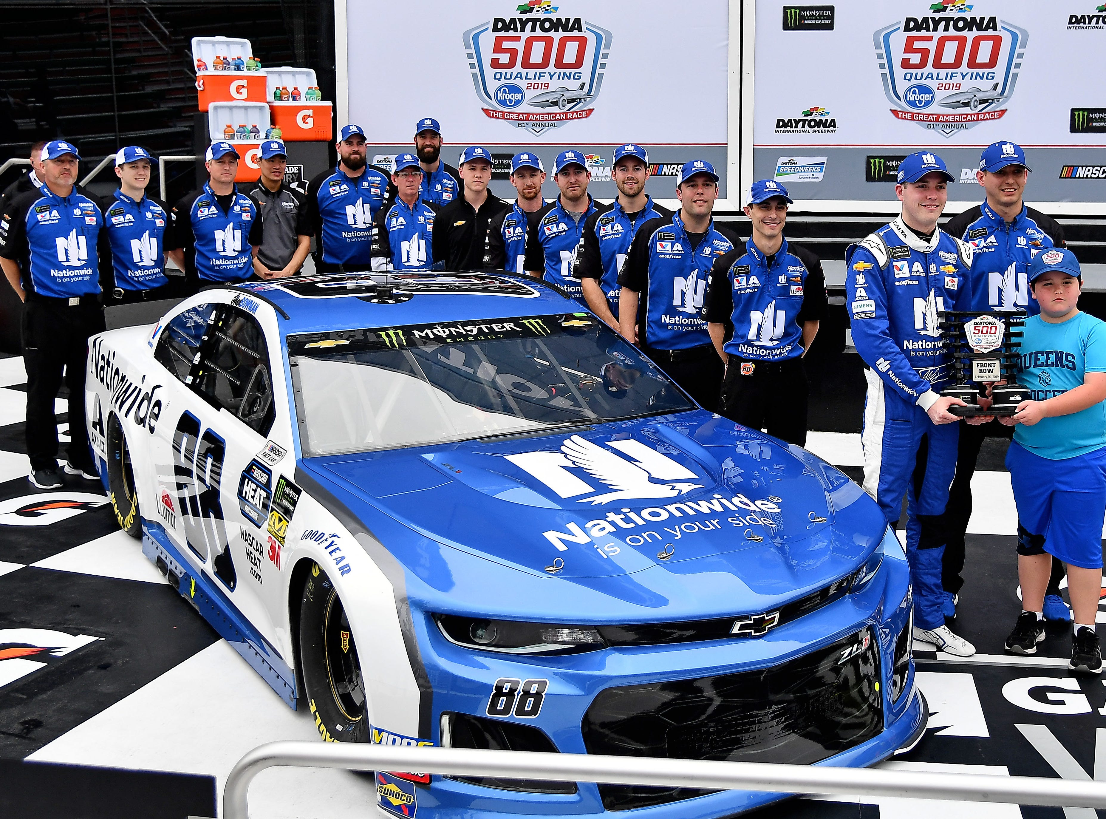 Feb 10:  Alex Bowman and his No. 88 team pose after qualifying second for the 2019 Daytona 500. Bowman won the Daytona 500 pole last year.
